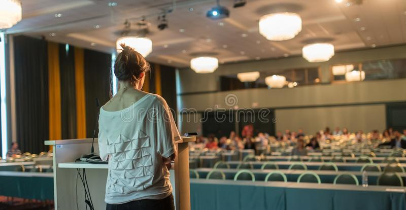 Public speaker giving talk at scientific conference. stock image