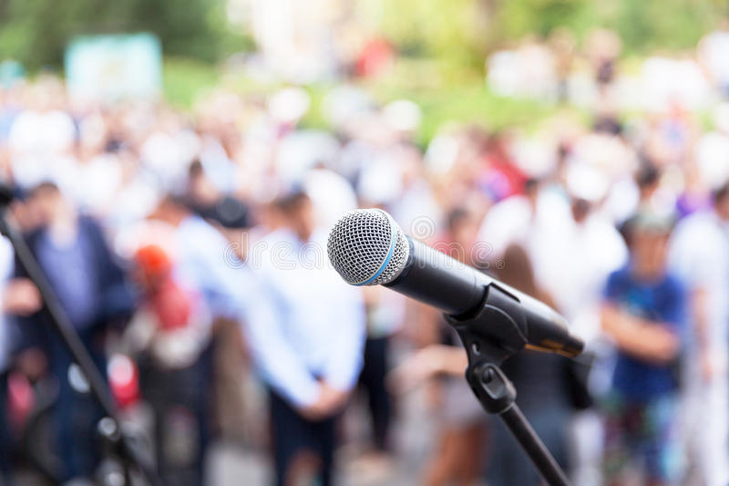 Public speaking. Microphone in focus against blurred audience. Protest. Public demonstration royalty free stock photos