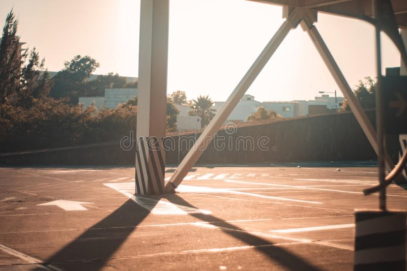 Public street parking column sunny day exterior. Empty public street parking lot on sunny day column structure exterior stock image