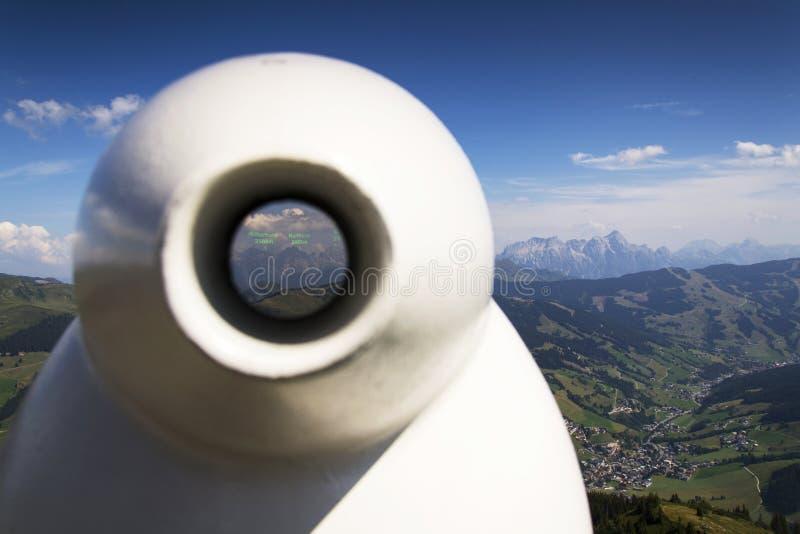 Public telescope arrayed against Loferer Mountains in Alps Austria. Public telescope arrayed against Loferer Mountains - mountain range in the Northern Limestone stock photo