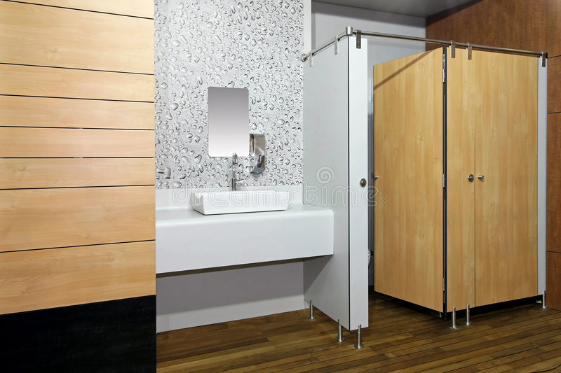 Public toilet. Room with double cabins angle royalty free stock photos