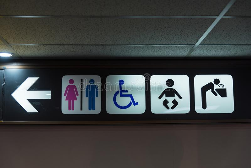 A public toilet with disabled access sign in the airport terminal.Thailand stock photography