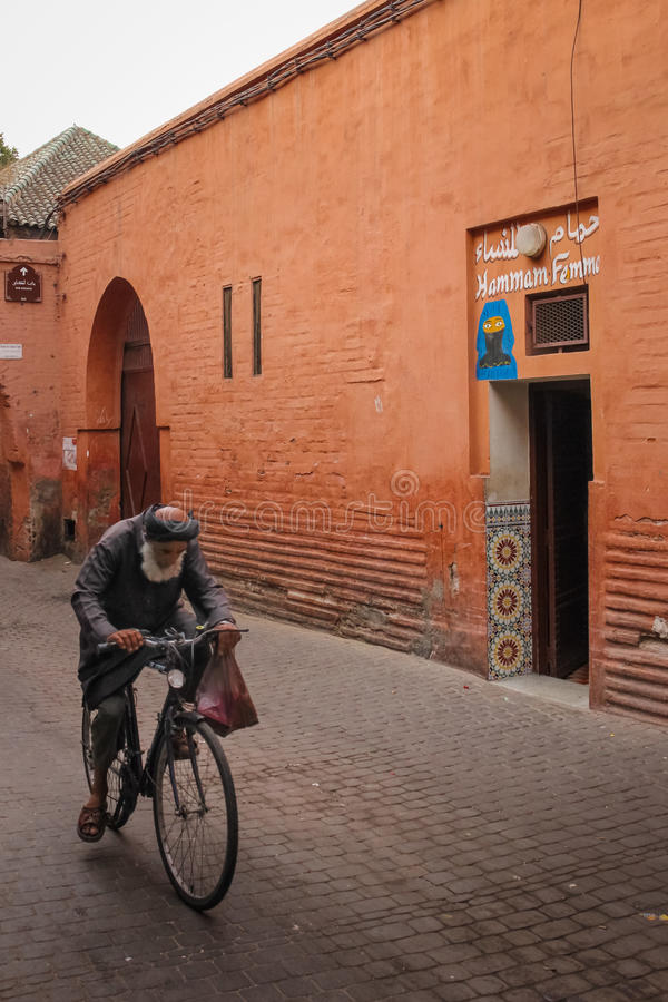 Public toilet for women. Marrakesh. Morocco. A public toilet for women at the Souk. man passing by in a bicycle. Marrakesh. Morocco royalty free stock photography