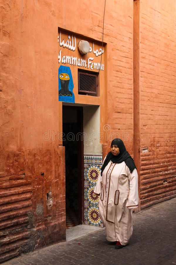 Hammam. Public bath for women. Marrakesh . Morocco. A hammam or public toilet for women at the Souk. Woman standing. Marrakesh . Morocco stock image