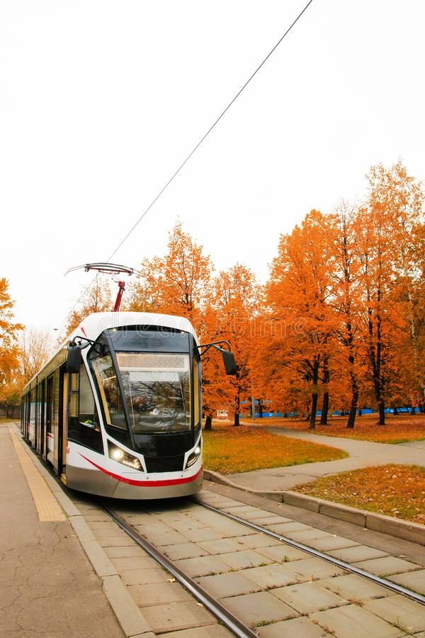 Public transport, modern city tram, approaching the bus stop royalty free stock image