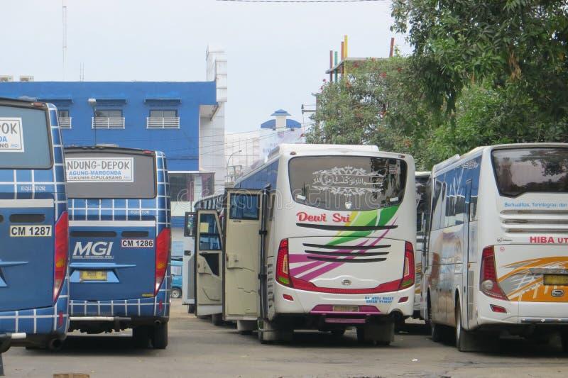 Public transportation in Depok. DEPOK, INDONESIA - March 10, 2017: Buses queuing at Terminal Depok royalty free stock photo