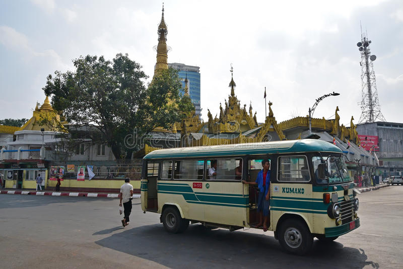 Public transportation in downtown Yangon, Myanmar. Public transportation in front of Sule Pagoda in downtown Yangon, Myanmar. Bus is the most common public stock images