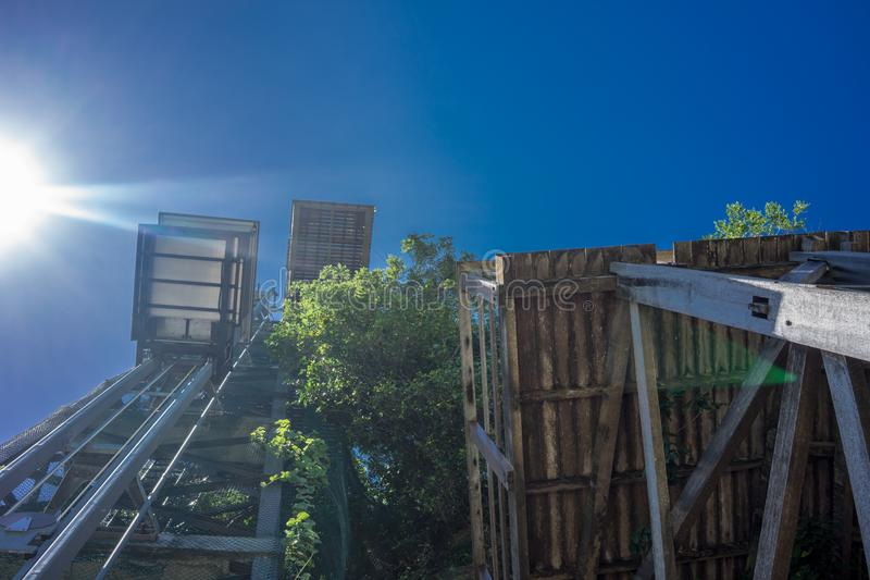 Low angle view of outdoor elevater with blue sky royalty free stock image