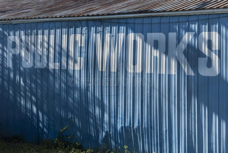 Public works sign on building stock photography