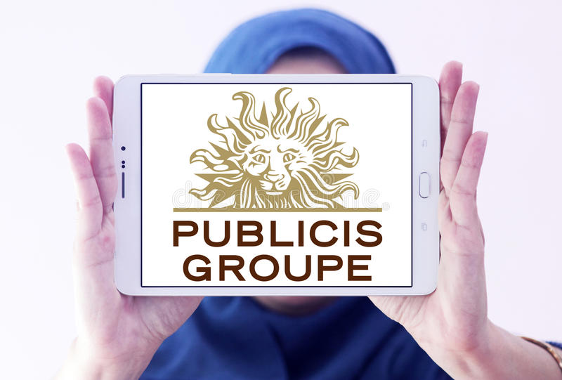 Publicis Groupe company logo. Logo of Publicis Groupe company on samsung tablet holded by arab muslim woman. Publicis Groupe is a French multinational royalty free stock photos