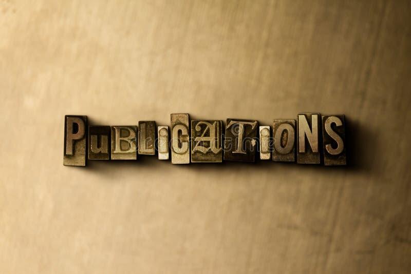 PUBLIKATIONER - närbild av det typsatta ordet för grungy tappning på metallbakgrunden royaltyfri illustrationer