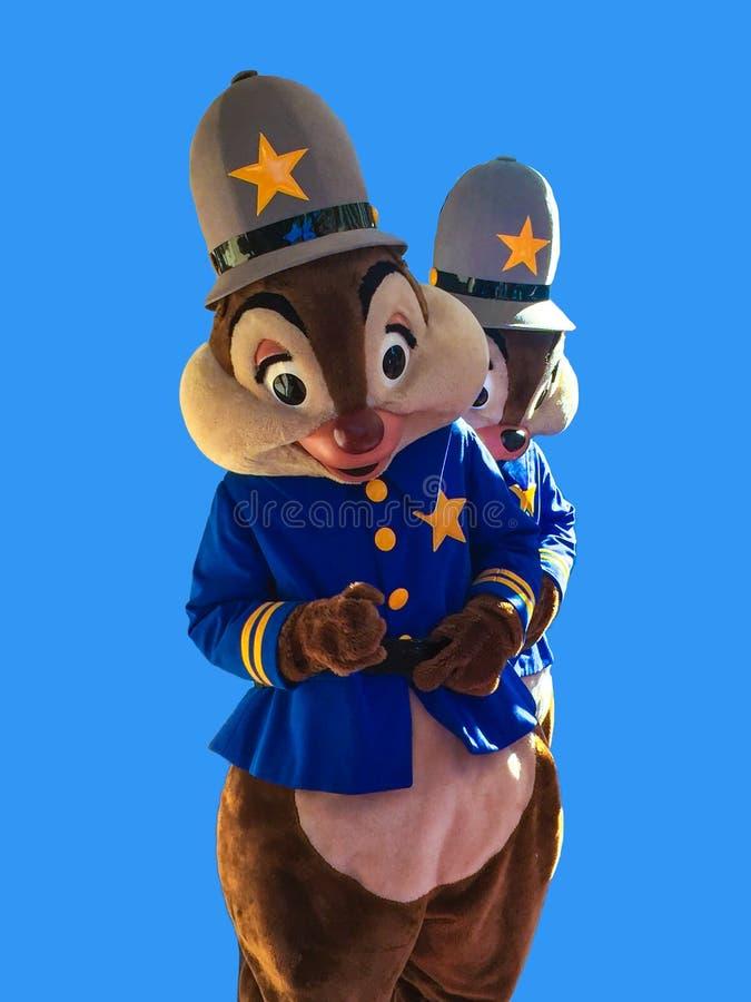 Puce et Dale Disney Characters sur le fond bleu photo libre de droits