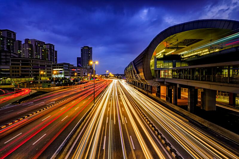 Light trail of busy traffic with LRT station railway, office buildings and dark blue sky at the background in Puchong, Malaysia. Puchong, Selangor, Malaysia - 14 stock photos