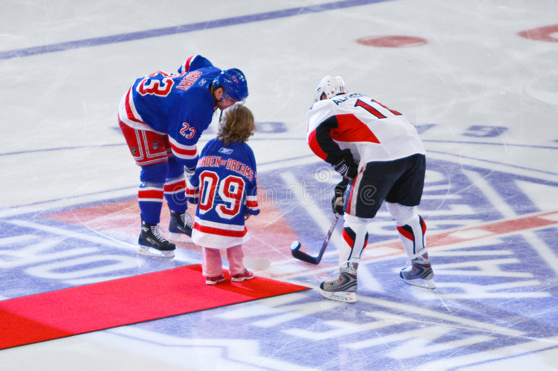 Puck Drop. A young girl with a serious illness drops the first puck at Madison Square Garden for the Rangers vs. Senators 3-22-09 during Garden of Dreams Night royalty free stock images