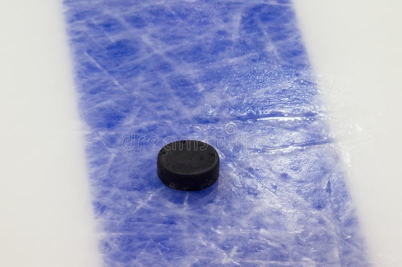 Puck on ice hockey rink surface, sport background.  stock photos