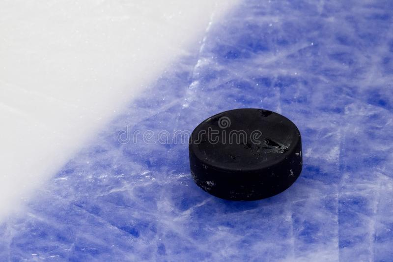 Puck on ice hockey rink surface, sport background.  stock images