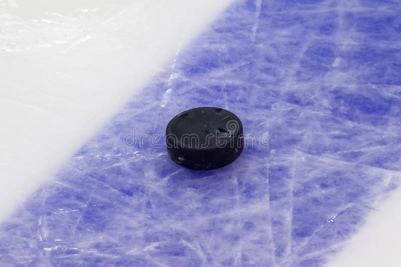 Puck on ice hockey rink surface, sport background.  stock image