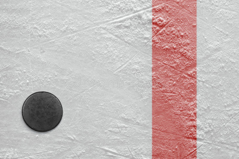 Puck on ice. Puck lying on a hockey rink. Texture, background stock image