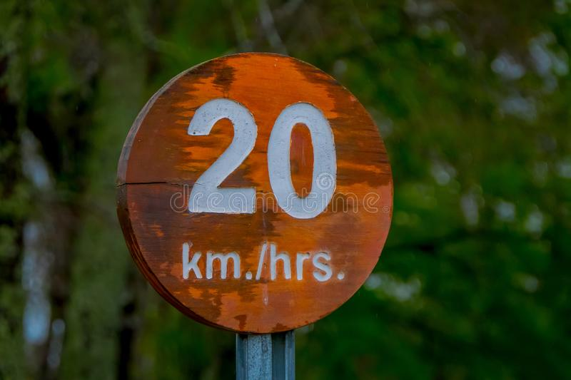 PUCON, CHILE - SEPTEMBER, 23, 2018: Close up of wooden informative sign of 20 km hrs inside of the Pucon recreative. Place in Chile stock photos