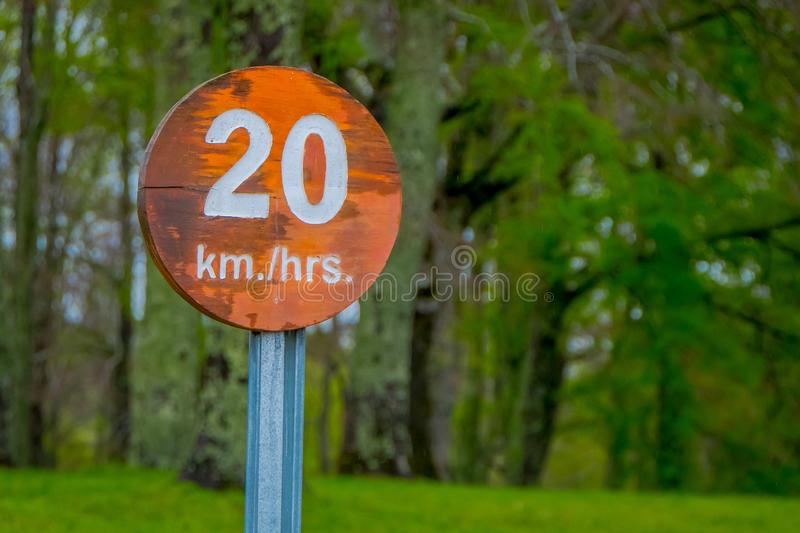 PUCON, CHILE - SEPTEMBER, 23, 2018: Close up of wooden informative sign of 20 km hrs inside of the Pucon recreative. Place in Chile stock photography