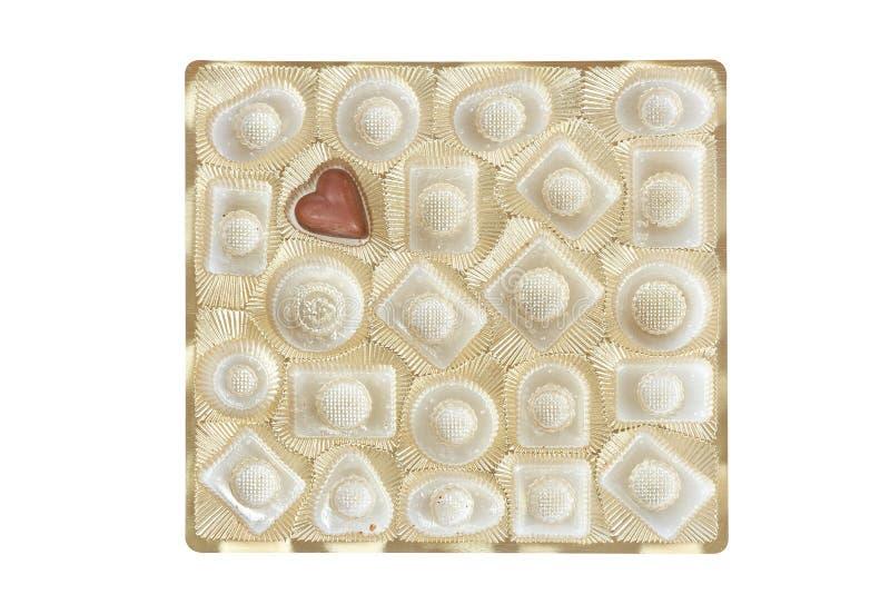 pudełkowatego candie czekoladowy złoto odizolowywał zdjęcia royalty free