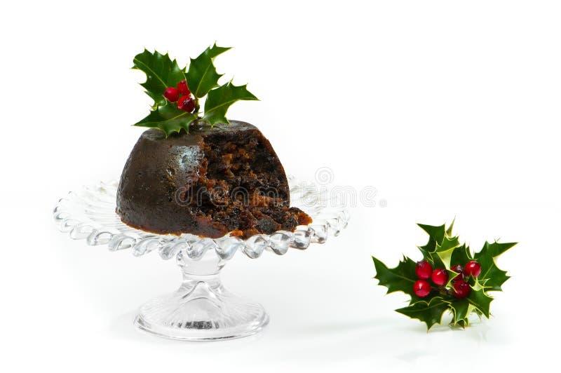 Pudim do Natal com azevinho imagens de stock royalty free