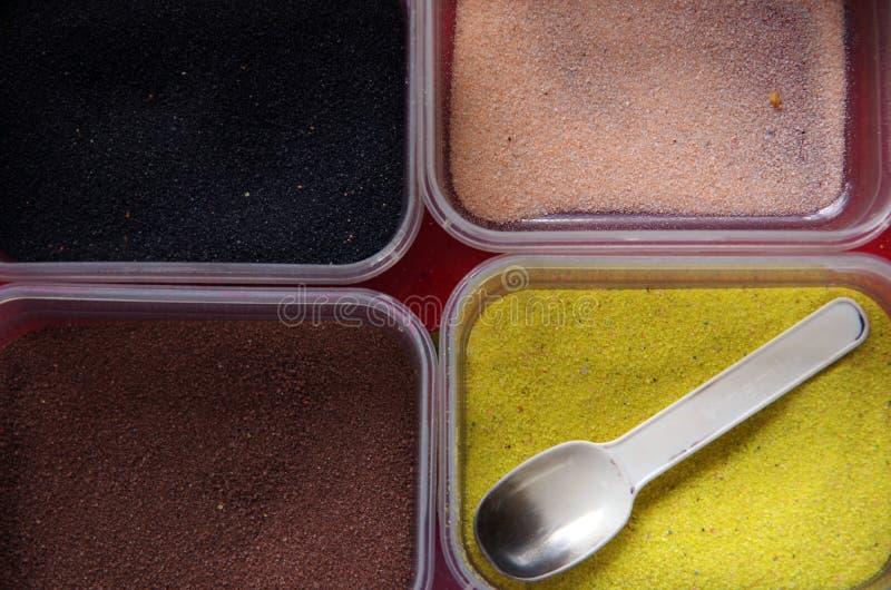 Pudra sand för att måla, leksaker för unge` s royaltyfria foton
