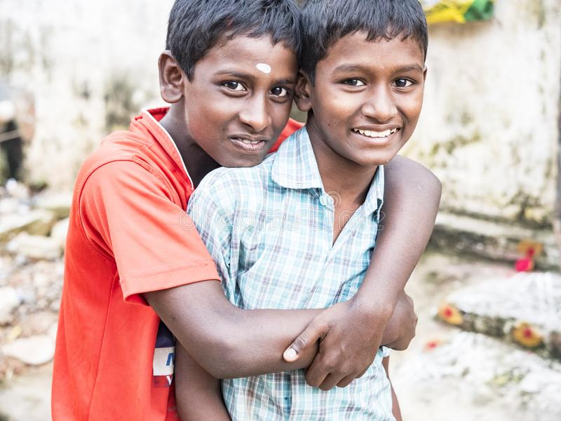 Unidentified best children boys friends smiling standing with hand on shoulder enjoying friendship royalty free stock photos