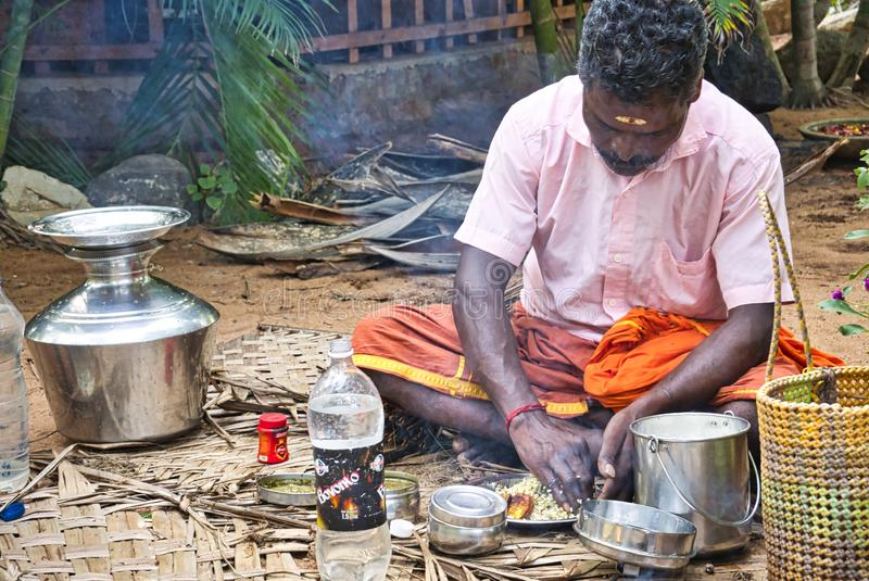 Poor Indian Dalit people having lunch on the floor. PUDUCHERRY, INDIA - DECEMBER Circa, 2018. Unidentified Poor Indian Dalit people having lunch on the floor stock photography