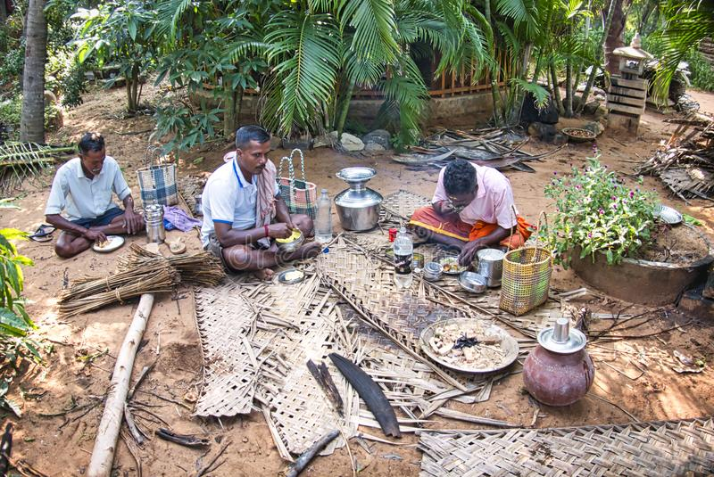 Poor Indian Dalit people having lunch on the floor. PUDUCHERRY, INDIA - DECEMBER Circa, 2018. Unidentified Poor Indian Dalit people having lunch on the floor stock photo