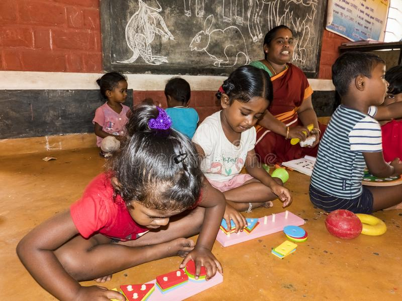 Interior of poor kids playing government room. Children`s entertainment, recreation, sports, educational games indoor. PUDUCHERY, INDIA - DECEMBER Circa, 2018 royalty free stock image