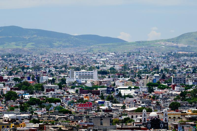 Puebla, Mexico City View. A view of the cityscape of Puebla, Mexico from the top of a hill royalty free stock photography