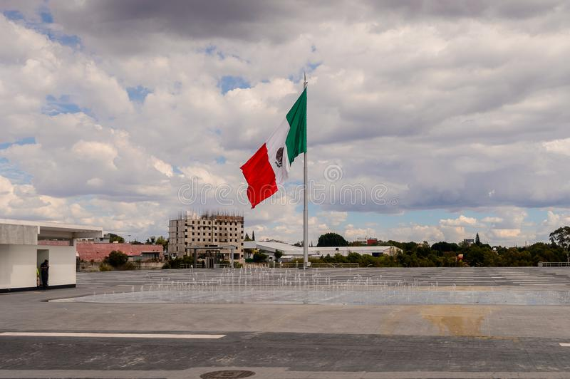 Architecture of Puebla, Mexico. PUEBLA, MEXICO - OCT 30, 2016: Mexican flag in Puebla, Mexico. The city was founded in 1531 in an area called Cuetlaxcoapan stock photos