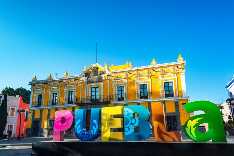Puebla Sign and Theater. Puebla sign and historic theater in Puebla, Mexico royalty free stock photo