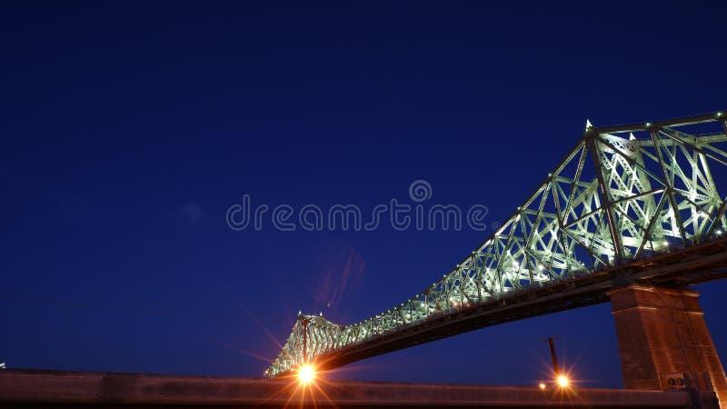 Puente de Jacques Cartier iluminado en la noche fotos de archivo