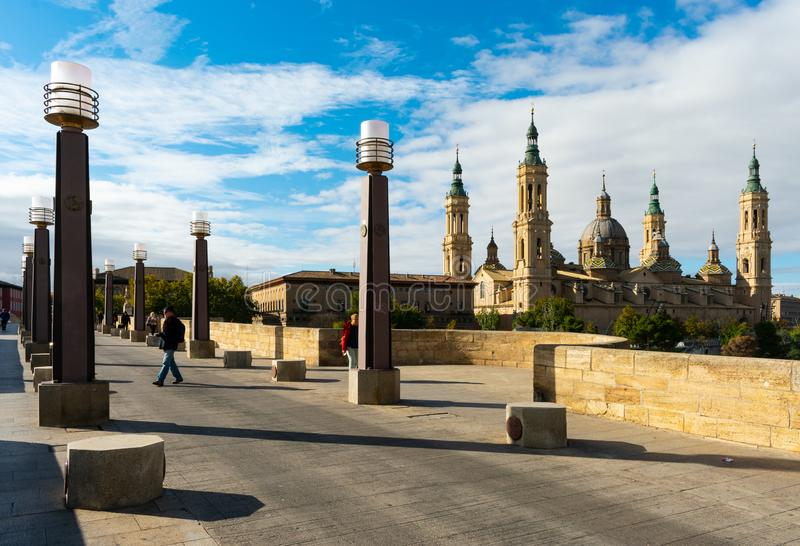 Zaragoza, Spain/Europe; 12/1/2019: Puente de Piedra Stone Bridge and the Basilica of Our Lady of the Pillar in the downtown of stock photography