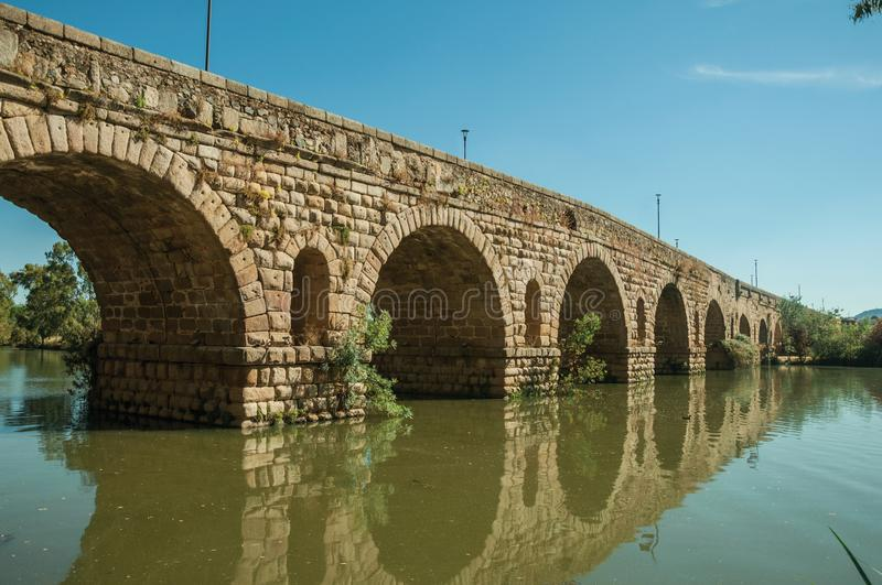 Puente Romano arches on the Guadiana River at Merida royalty free stock photography