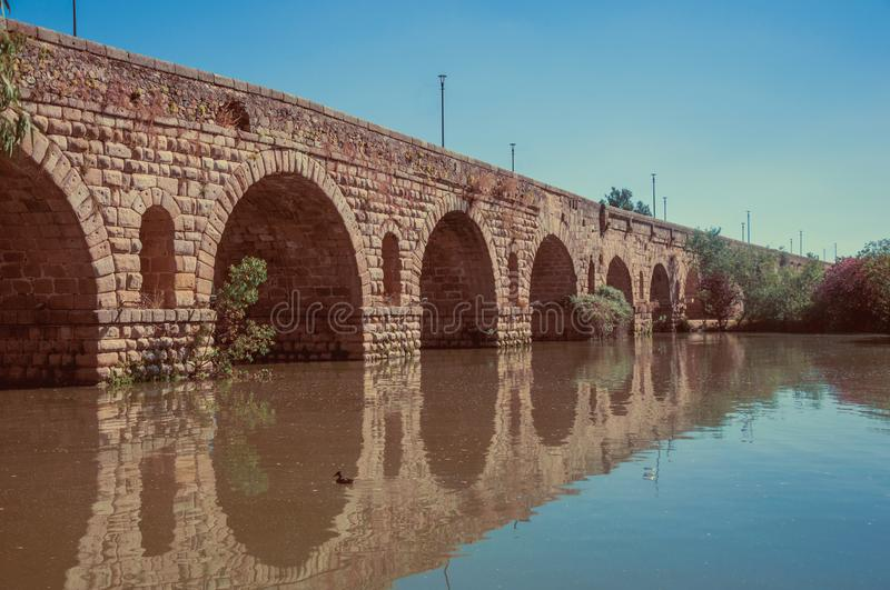 Puente Romano arches on the Guadiana River at Merida royalty free stock images