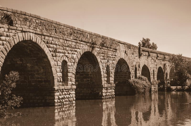 Puente Romano arches on the Guadiana River at Merida stock photo