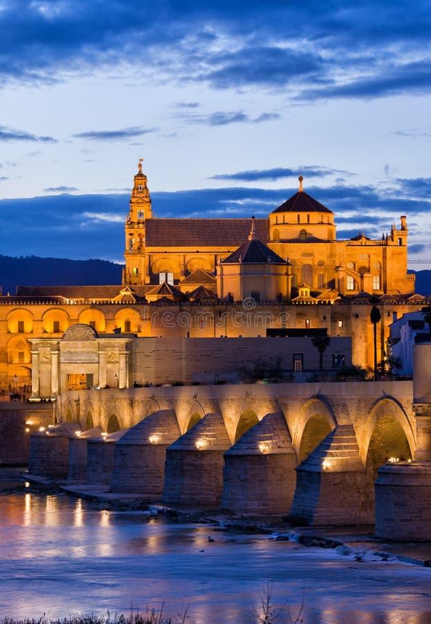 Puente Romano and Mezquita at Twilight in Cordoba stock image