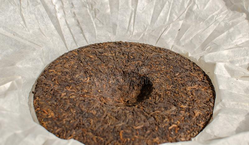 Puer or pu-erh - Pressed fermented tea royalty free stock image