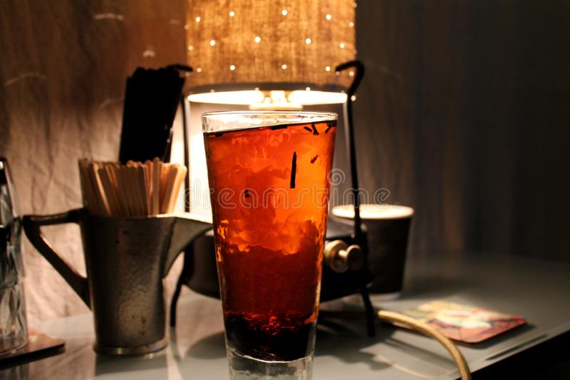 Puer tea in tall glass. In cafe royalty free stock photography