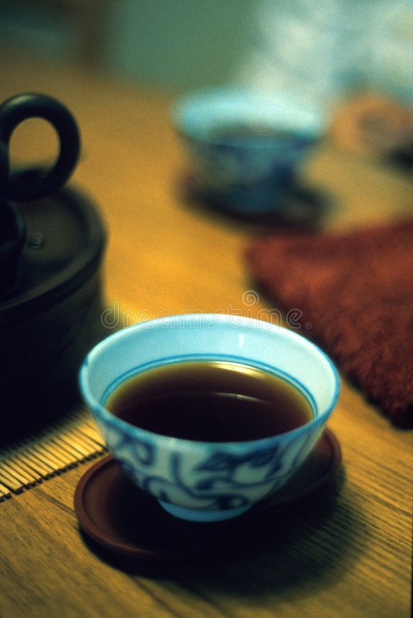 Puer tea from Yunnan, China. Yunann Puer tea a highly acclaimed Chinese seasoned black tea in a fine China porcelain cup royalty free stock photo