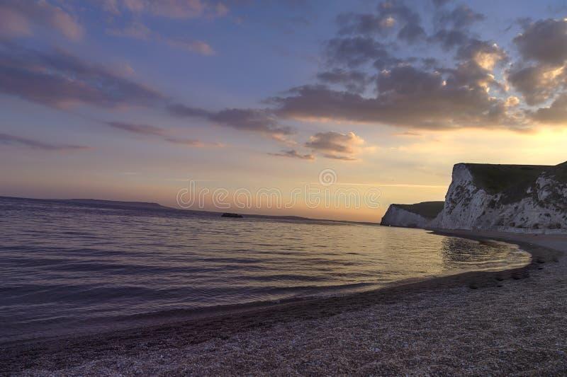 Puerta de Durdle - puesta del sol - lugar turístico fotos de archivo