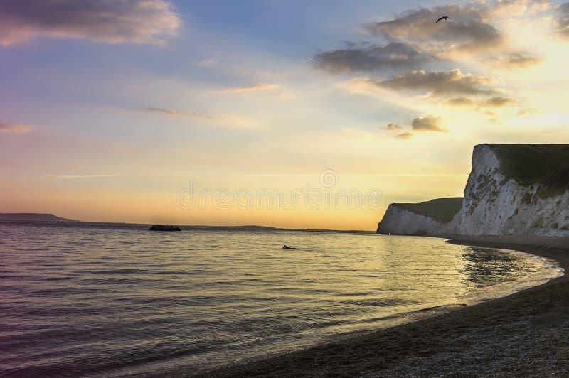 Puerta de Durdle - puesta del sol - lugar turístico imágenes de archivo libres de regalías