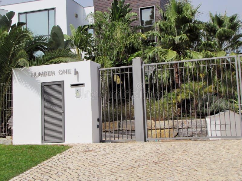 Puerta de la casa número uno imágenes de archivo libres de regalías