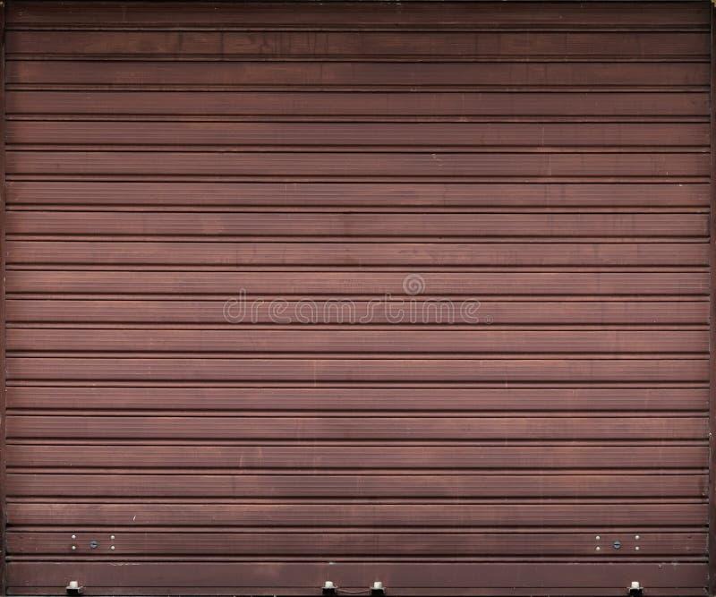 Puerta del garaje, textura del fondo del obturador del rodillo imagenes de archivo