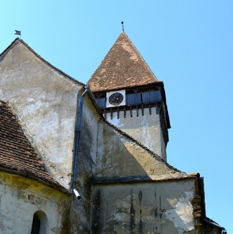 puerta Iglesia evangélica sajona medieval fortificada en el pueblo Toarcla, Tartlau, Transilvania, Rumania imagen de archivo