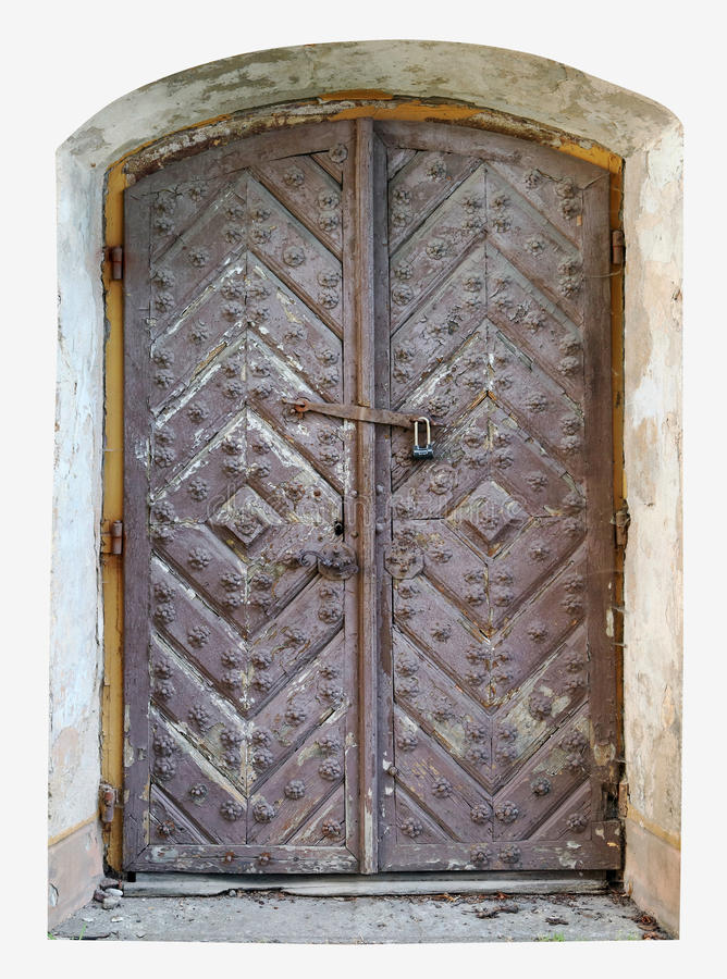 Puerta putrefacta bloqueada a la mazmorra de un castillo arruinado medieval co imagenes de archivo
