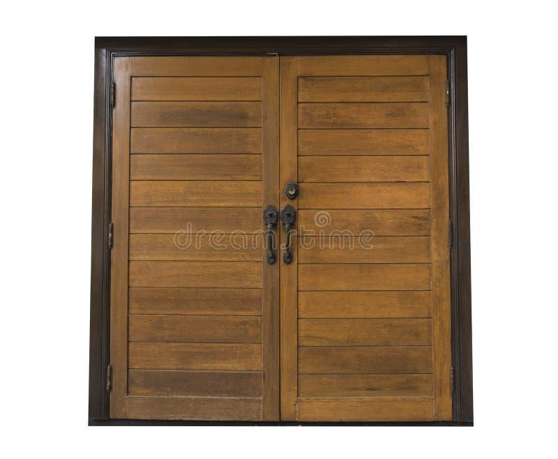 Puertas dobles de madera viejas aisladas en el fondo blanco imagenes de archivo